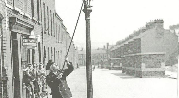 A lamplighter at one of the 10,000 gas lights in Belfast's streets
