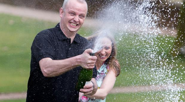 Car mechanic and racing driver Neil Trotter, with partner Nicky Ottaway, celebrates his win in Dorking, Surrey where he was revealed as the man who scooped a £107.9 million jackpot on the Euromillions lottery.
