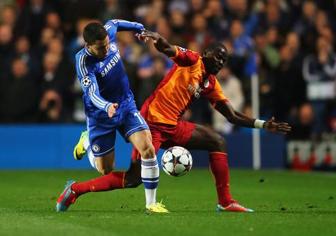 Eden Hazard of Chelsea battles with Emmanuel Eboue of Galatasaray during the UEFA Champions League Round of 16 second leg match between Chelsea and Galatasaray AS at Stamford Bridge