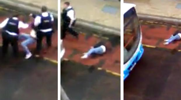 The video appears to show PSNI officers moving the woman to a bus stop before a bus pulls up close to her