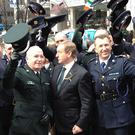 PSNI officers join their Garda colleagues and Taoiseach Enda Kenny for the St Patrick's Day parade