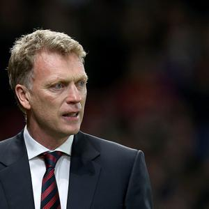 Manchester United manager David Moyes prior to kick-off during the UEFA Champions League, Round of 16, second leg match at Old Trafford, Manchester. PRESS ASSOCIATION Photo. Picture date: Wednesday March 19, 2014. See PA story SOCCER Man Utd. Photo credit should read: Peter Byrne/PA Wire
