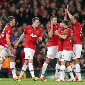 Manchester United's Robin van Persie (centre right) celebrates scoring their second goal of the game with team-mates during the UEFA Champions League, Round of 16, second leg match at Old Trafford, Manchester. PRESS ASSOCIATION Photo. Picture date: Wednesday March 19, 2014. See PA story SOCCER Man Utd. Photo credit should read: Peter Byrne/PA Wire