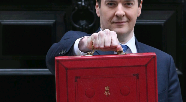 The Chancellor of the Exchequer George Osborne holding the budget box outside Number 11
