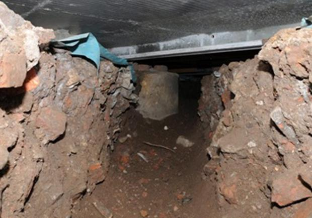 Undated handout photo issued by Greater Manchester Police of a 50 ft tunnel that was dug by thieves from nearby wasteland into the Tesco on Liverpool Road, Eccles. A significant amount of cash was taken from an ATM during the theft on Friday March 14th