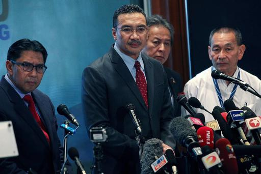 Malaysia's Minister of Defence and Acting Transport Minister Hishammuddin Hussein (2R) listens to questions from the floor during a press conference on March 20, 2014 in Kuala Lumpur, Malaysia. (Photo by Rahman Roslan/Getty Images)