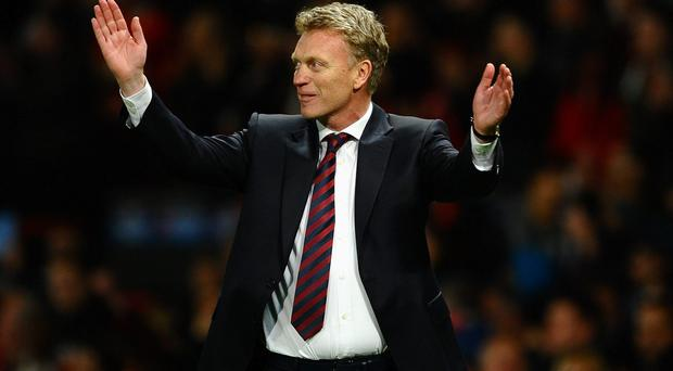 MANCHESTER, ENGLAND - MARCH 19: Manchester United Manager David Moyes celebrates at the end of the UEFA Champions League Round of 16 second round match between Manchester United and Olympiacos FC at Old Trafford on March 19, 2014 in Manchester, England. (Photo by Laurence Griffiths/Getty Images)
