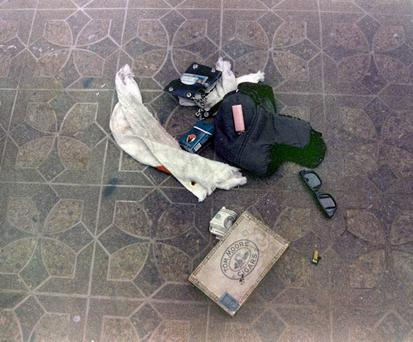 This April 1994 photo provided by the Seattle Police Department shows items found at the scene of Kurt Cobain's suicide, in Seattle. The image has never before been released. Police spokeswoman Renee Witt said Thursday, March 20, 2014, that several rolls of undeveloped film were found when a detective re-examined the Cobain case recently. (AP Photo/Seattle Police Department)
