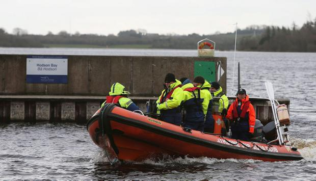 Members of the Athlone sub aqua club, return to Hodson Bay, having taken part in the search of Lough Ree in Co Westmeath, for a man who is still missing following an accident where the boat he was in with two others capsized yesterday afternoon