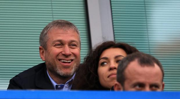 LONDON, ENGLAND - MARCH 22: Chelsea owner Roman Abramovich smiles during the Barclays Premier League match between Chelsea and Arsenal at Stamford Bridge on March 22, 2014 in London, England. (Photo by Richard Heathcote/Getty Images)