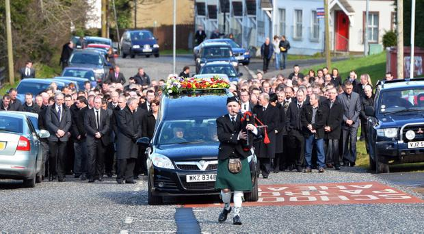 Family and friends follow the funeral of helicopter crash victim Declan Small in the village of Mayobridge, Co Down. Mr Small was a site foreman for Lord Ballyedmond's company Norbrook Laboratories. Mark Marlow/Pacemaker