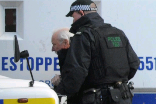 Ivor Bell is taken away by police after being refused bail. Colm Lenaghan/Pacemaker