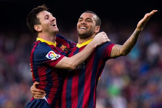 BARCELONA, SPAIN - MARCH 16: Lionel Messi of FC Barcelona celebrates with his teammate Daniel Alves after scoring his team's sixth goal during the La Liga match between FC Barcelona and CA Osasuna at Camp Nou on March 16, 2014 in Barcelona, Spain. (Photo by Alex Caparros/Getty Images)