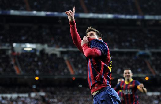 MADRID, SPAIN - MARCH 23: Lionel Messi of Barcelona celebrates scoring his team's fourth goal during the La Liga match between Real Madrid CF and FC Barcelona at the Bernabeu on March 23, 2014 in Madrid, Spain. (Photo by Denis Doyle/Getty Images)