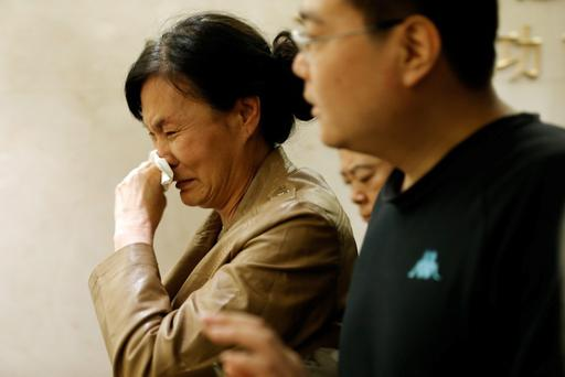A family member of a passenger from the missing Malaysia Airlines flight MH370