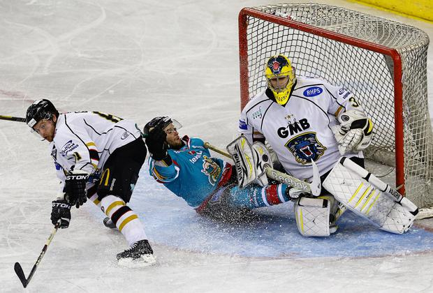 22/3/14: Darryl Lloyd of the Belfast Giants in action against Dan Green of the Nottingham Panthers during the Elite League game at the Odyssey Arena, Belfast.