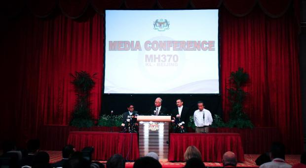 KUALA LUMPUR, MALAYSIA - MARCH 24: Prime Minister of Malaysia, Najib Razak delivers a statement during an ad hoc press conference on March 24, 2014 in Kuala Lumpur, Malaysia in which he announced that fresh analysis of available satellite data has concluded that missing flight MH370's final position was in the southern Indian Ocean. (Photo by Rahman Roslan/Getty Images)