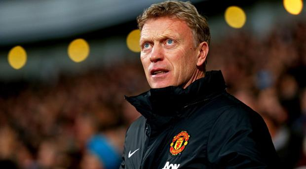 David Moyes' faltering Manchester United side face a stern test this evening against rivals Manchester City. (Photo by Paul Gilham/Getty Images)