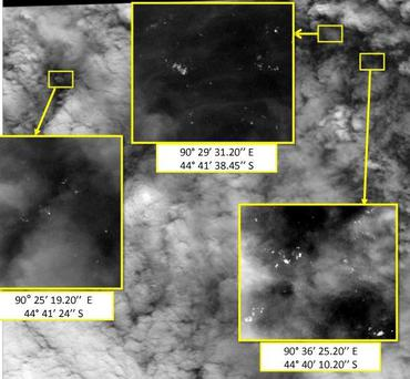Satellite imagery taken on March 23 shows the approximate positions of objects seen floating in the southern Indian Ocean in the search zone for the missing Malaysia Airlines Flight 370. (AP Photo/Malaysian Remote Sensing Agency)