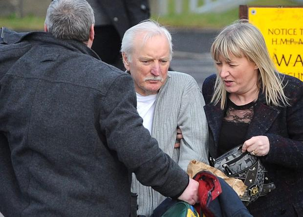 Former IRA chief Ivor Bell's family try to keep him covered from the media as he emerges from Maghaberry Prison after being granted bail. He was arrested and charged with membership of the IRA and involvement in the murder of Jean McConville in December 1972. Photo Colm Lenaghan/Pacemaker