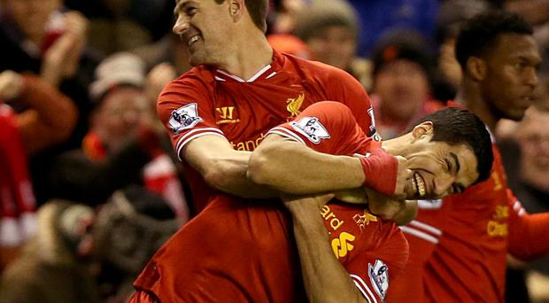 Liverpool's Steven Gerrard (left) celebrates with team-mate Luis Suarez after scoring his side's first goal of the game during the Barclays Premier League match at Anfield, Liverpool.