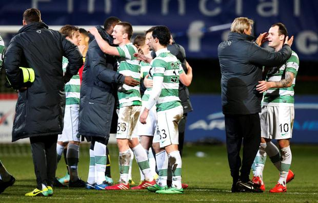 Celtic's Anthony Stokes (right) celebrates with team mates and staff winning the league following the Scottish Premier League match at Firhill Stadium, Glasgow.