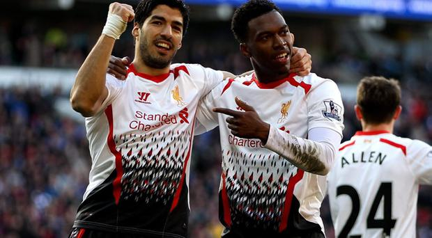 Daniel Sturridge (right) and Luis Suarez have fired Liverpool into contention for the Premier League title (Photo by Ben Hoskins/Getty Images)