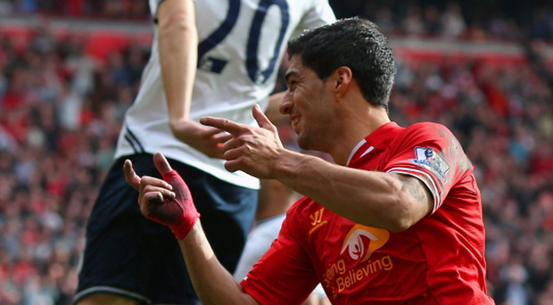 Luis Suarez of Liverpool celebrates scoring the second goal during the Barclays Premier League match between Liverpool and Tottenham Hotspur at Anfield