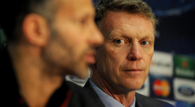 Manchester United manager David Moyes (right) and Ryan Giggs, during a press conference at Old Trafford, Manchester