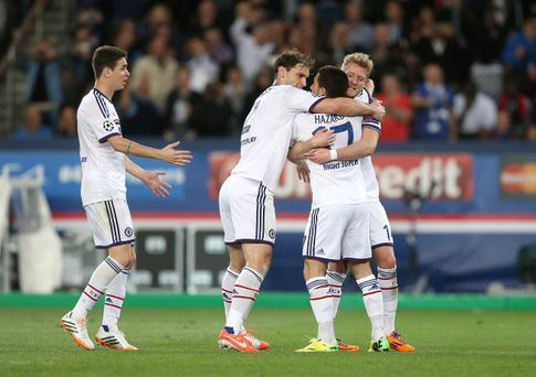 Chelsea's Eden Hazard (second right) celebrates scoring their first goal of the game with team-mates Andre Schurrle (right) and Branislav Ivanovic during the Champions League Quarter Final, First Leg match at the Parc des Princes, Paris, France