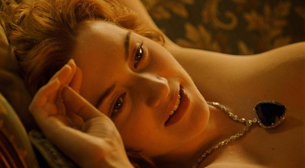 The scene in Titanic where Kate Winslet's character Rose is painted nude. Copyright 20th century Fox