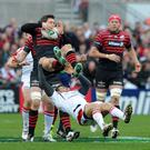 Jared Payne clashes with Alex Goode during the Heineken Cup quarter final game between Ulster and Saracens at Ravenhill, Belfast. Photo: Pacemaker