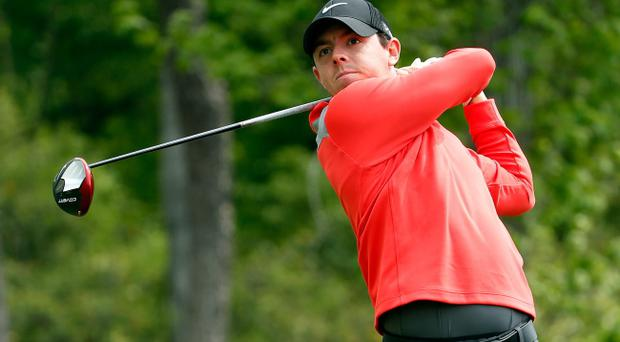 Rory McIlroy of Northern Ireland watches his tee shot on the thirteenth hole during round three of the Shell Houston Open at the Golf Club of Houston on April 5, 2014 in Humble, Texas. (Photo by Scott Halleran/Getty Images)