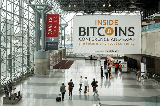 People attend a Bitcoin conference on at the Javits Center April 7, 2014 in New York City. Topics included market places to trade bitcoin, mining hardware to harvest bitcoins and digital wallets to store bitcoins. Bitcoin is one of the most popular of over one hundred digital currencies that have recently come into popularity. (Photo by Andrew Burton/Getty Images)