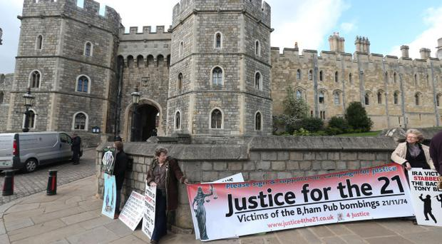 Protestors (names not known) outside Windsor Castle, calling for justice for victims of the 1974 Birmingham pub bombings, ahead of the attendance of Deputy First Minister and ex-IRA commander Martin McGuinness at a state banquet.