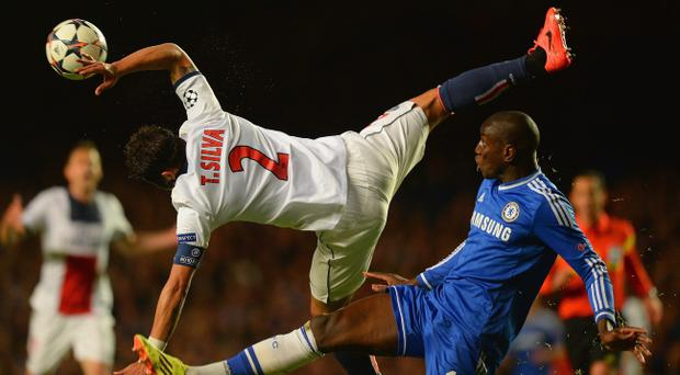 LONDON, ENGLAND - APRIL 08: Thiago Silva of PSG clashes with Demba Ba of Chelsea during the UEFA Champions League Quarter Final second leg match between Chelsea and Paris Saint-Germain FC at Stamford Bridge on April 8, 2014 in London, England. (Photo by Mike Hewitt/Getty Images)