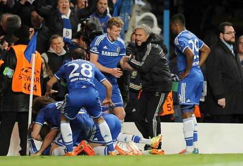 Chelsea's manager Jose Mourinho joins in the celebrations after Demba Ba scores his side's second goal during the UEFA Champions League Quarter Final match at Stamford Bridge, London