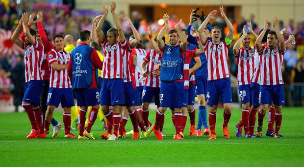 MADRID, SPAIN - APRIL 09: Club Atletico de Madrid celebrate victory during the UEFA Champions League Quarter Final second leg match between Club Atletico de Madrid and FC Barcelona at Vicente Calderon Stadium on April 9, 2014 in Madrid, Spain. (Photo by Gonzalo Arroyo Moreno/Getty Images)