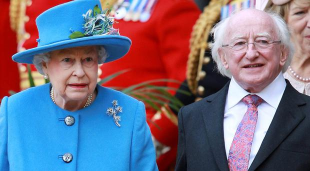 Queen Elizabeth II walks with President of Ireland Michael D Higgins and Sabrina Higgins at Windsor Castle