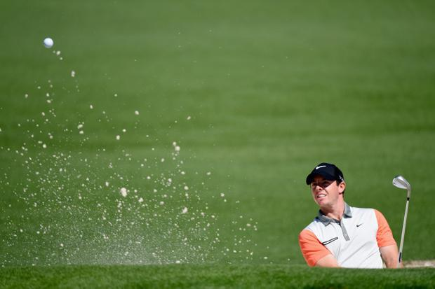 Rory McIlroy of Northern Ireland plays a bunker shot on the second hole during the first round of the 2014 Masters Tournament at Augusta National Golf Club on April 10, 2014 in Augusta, Georgia. (Photo by Harry How/Getty Images)