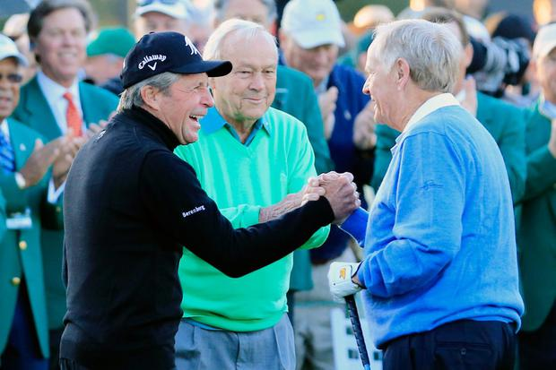 Honorary starters Gary Player, Arnold Palmer and Jack Nicklaus greet each other on the first tee at the start of the first round of the 2014 Masters Tournament at Augusta National Golf Club on April 10, 2014 in Augusta, Georgia. (Photo by Rob Carr/Getty Images)