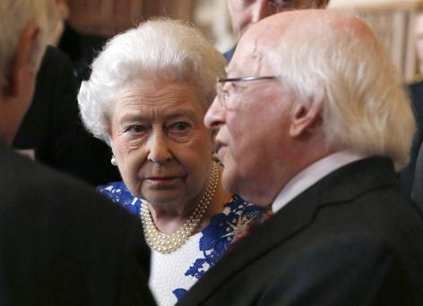 Queen Elizabeth ll and Ireland's President Michael D Higgins attend a Northern Ireland-themed reception at Windsor Castle on April 10, 2014 in Windsor, United Kingdom. The event was organised as part of Irish President Michael D Higgins' four-day state visit. The visit comes three years after Queen Elizabeth II made a groundbreaking trip to the republic, which helped to heal deep-rooted unease and put British-Irish relations on a new footing. (Photo by Luke MacGregor - WPA Pool/Getty Images)