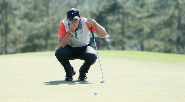 AUGUSTA, GA - APRIL 10: Rory McIlroy lines up a putt on the 18th green during the first round of the 2014 Masters Tournament at Augusta National Golf Club on April 10, 2014 in Augusta, Georgia. (Photo by Andrew Redington/Getty Images)
