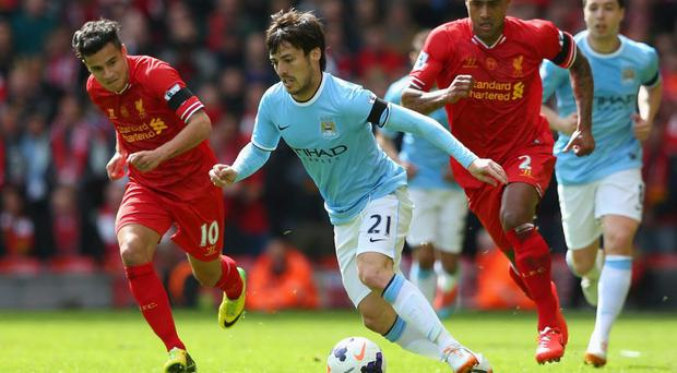 David Silva of Manchester City competes with Philippe Coutinho of Liverpool during the Barclays Premier League match between Liverpool and Manchester City at Anfield on April 13, 2014 in Liverpool, England. (Photo by Alex Livesey/Getty Images)