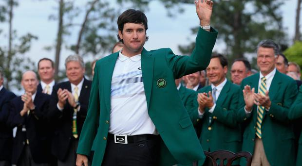 AUGUSTA, GA - APRIL 13: Bubba Watson of the United States poses with the green jacket after winning the 2014 Masters Tournament by a three-stroke margin at Augusta National Golf Club on April 13, 2014 in Augusta, Georgia. (Photo by David Cannon/Getty Images)