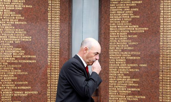 Former Liverpool Goalkeeper Bruce Grobbelaar walks past the Hillsborough Memorial before the Barclays Premier League match between Liverpool and Manchester City at Anfield on Sunday