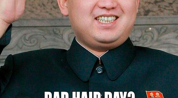 Photo issued by M&M Hair Academy in South Ealing, west London, of window poster poking fun at North Korean leader Kim Jong-un unusual hairstyle, as North Korean officials visited the salon over the display of their leader's poster in the salon's window. Barber Karim Nabbach, 26, said that salon manager Mo Nabbach was confronted by two men claiming to be officials from the country, demanding to know his name.