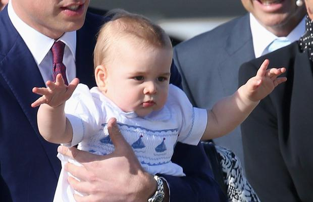 Prince William, Duke of Cambridge carries Prince George of Cambridge as they arrive at Sydney Airport on a Australian Airforce 737 aircraft on April 16, 2014 in Sydney, Australia.