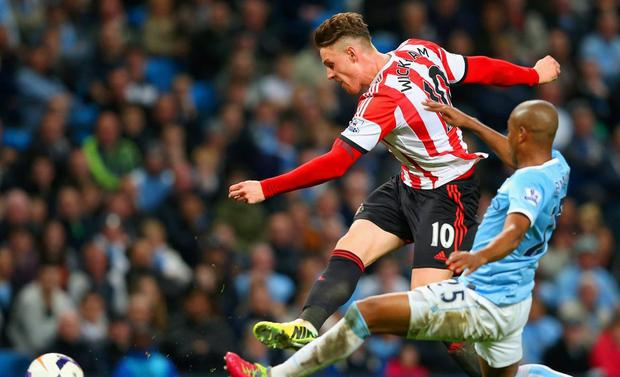 Connor Wickham of Sunderland scores their second goal under pressure from Fernandinho of Manchester City