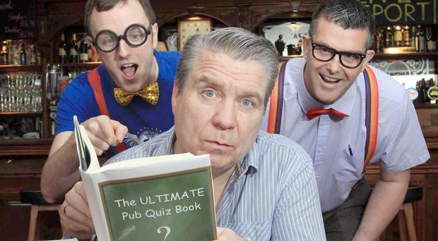 U105 drivetime presenter Johnny Hero (centre) joined Ricky Watts (left) and John Baxter of KP Snacks (NI) to launch this year's McCoy's NI Pub Quiz 2014